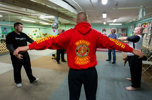 JAY YOUNG | THE GOSHEN NEWS<br /> Wearing a bright red Marine sweatshirt, Marine veteran Bill Campbell stretches and warms up during a martial arts training session on Feb. 9, 2017 in Elkhart.