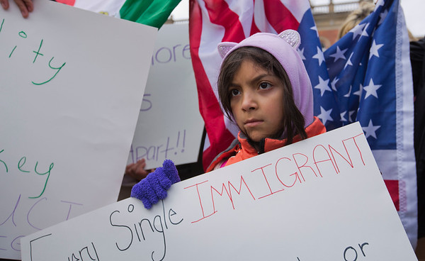 JAY YOUNG | THE GOSHEN NEWS<br /> Nine-year-old Amyrah Tovar, of Bristol, holds a sign while gathering with protesters outside the Elkhart County Courthouse Thursday afternoon.