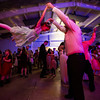 JAY YOUNG | THE GOSHEN NEWS<br /> Seven-year-old Juliet Hochstetler goes flying high as she is tossed in the air by her dad, Jay, as they dance during the Daddy Daughter Valentine's Dance hosted by Goshen Parks and Recreation on Thursday evening at the Elkhart County fairgrounds.