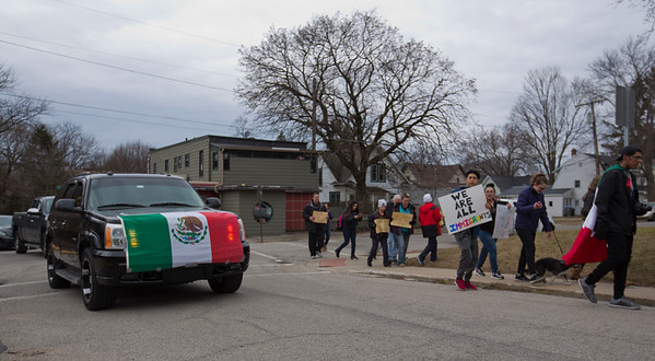 JAY YOUNG | THE GOSHEN NEWS<br /> A vehicle draped with a Mexican flag follows protesters on Thursday afternoon. They were out protesting President Donald Trump's immigration policies.