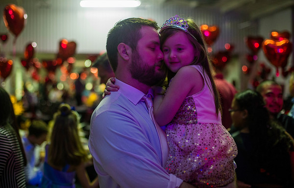 JAY YOUNG | THE GOSHEN NEWS<br /> Adam Morningstar holds his six-year-old daughter Keegan, both of Goshen, close as they slow dance during the Daddy Daughter Valentine's Dance hosted by Goshen Parks and Recreation on Thursday evening at the Elkhart County fairgrounds.