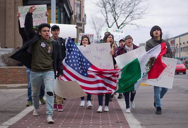 JAY YOUNG | THE GOSHEN NEWS<br /> Goshen High student Chris Serrano raises his arm as he leads protesters through downtown during a protest Thursday afternoon .