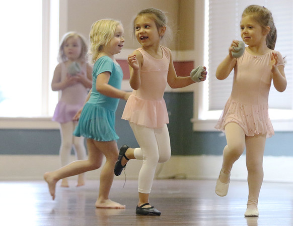JAY YOUNG | THE GOSHEN NEWS<br /> Five-year-old Julianna Moore, center, looks back as she jumps on one leg while her and classmates Rylee O'Brien, 4, and Phoebe Collat, 4, all of Goshen, play a rhythm game during their youth dance class hosted by Goshen Parks and Recreation on Wednesday afternoon.