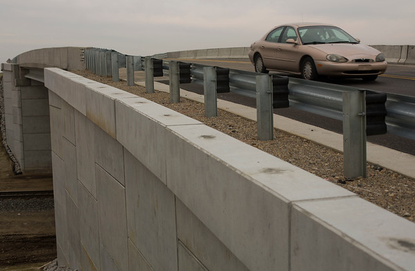 JAY YOUNG | THE GOSHEN NEWS<br /> A car travels west over the new railroad overpass on Waterford Mills Parkway Thursday afternoon.