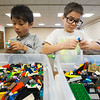 JAY YOUNG | THE GOSHEN NEWS<br /> Seven-year-old Hudson Burkholder, left, and eight-year-old Adam Miller, both of Middlebury, look through thousands of Lego bricks to find the right pieces for their builds during a Lego Club meeting Tuesday afternoon at Middlebury Public Library.