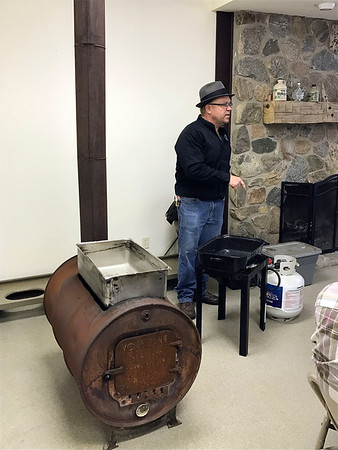 SHERRY VAN ARSDALL | THE GOSHEN NEWS  Courtney Franke, a Elkhart County Parks naturalist, talks about the different ways to cook sap to make maple syrup  during a backyard maple syrup workshop at Bonneyville Mill County Park in Bristol Saturday.