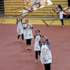 Roger Schneider | The Goshen News<br /> Members of the NorthWood Winter Guard toss their flags into the air Saturday during their show in Goshen.