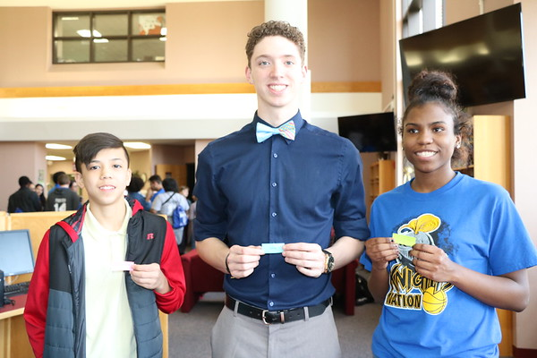 SHERRY VAN ARSDALL | THE GOSHEN NEWS<br /> At left, Caleb Happner, a fifth-grader at West Goshen Elementary, met Michael Younce and ALexis Jones, seniors at Southwestern Classical Academy in Flint, Michigan, during an ice-breaker activity at Goshen High School Thursday.