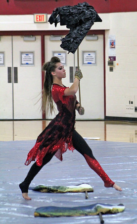 Roger Schneider | The Goshen News<br /> The Northridge Winter Guard team's show was all about ravens. Here Abigail Davis carries a raven prop during the Saturday performance.