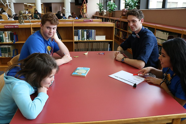 SHERRY VAN ARSDALL   THE GOSHEN NEWS<br /> At left, Anna Giles, a fourth-grader at West Goshen Elementary, talks with Lucas Yoder, a senior at Goshen High School, Michael Younce, a senior at Southwestern Classical Academy in Flint, Michigan, and Angy Cruz, a GHS senior, during an ice-breaker activity at Goshen High School Thursday.