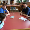 SHERRY VAN ARSDALL | THE GOSHEN NEWS<br /> At left, Anna Giles, a fourth-grader at West Goshen Elementary, talks with Lucas Yoder, a senior at Goshen High School, Michael Younce, a senior at Southwestern Classical Academy in Flint, Michigan, and Angy Cruz, a GHS senior, during an ice-breaker activity at Goshen High School Thursday.