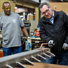 "JAY YOUNG | THE GOSHEN NEWS<br /> U.S. Senator Joe Donnelly, right, operates machinery under the watchful eye of a Robert Weed Plywood employee on Monday morning at the factory during a ""Donnelly Days"" event."