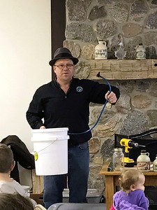 SHERRY VAN ARSDALL | THE GOSHEN NEWS  Courtney Franke, a Elkhart County Parks naturalist, talks about the different ways to collect sap to make maple syrup  during a backyard maple syrup workshop at Bonneyville Mill County Park in Bristol Saturday.