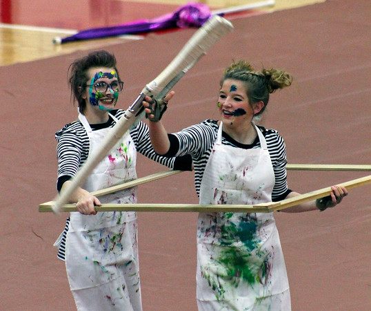 Roger Schneider | The Goshen News<br /> Members of the NorthWood Winter Guard team laugh and smile during their show that featured picture frames, paint and twirling rifles.