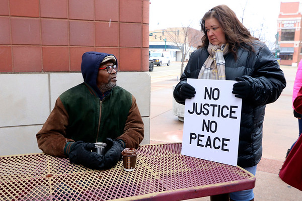 SHERRY VAN ARSDALL | THE GOSHEN NEWS Marci Greenroyd and her father, Charles Gary, attended a prayer vigil in Elkhart Saturday as a grand jury convenes in the death of family member, Norman Gary, who was fatally shot by two Elkhart police officers.