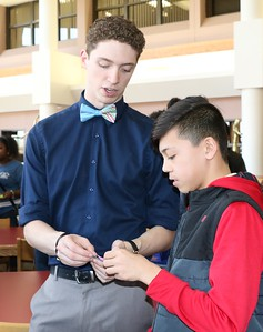 SHERRY VAN ARSDALL | THE GOSHEN NEWS At right, Caleb Happner, a fifth-grader at West Goshen Elementary, met Michael Younce, a senior at Southwestern Classical Academy in Flint, Michigan, during an ice-breaker activity at Goshen High School Thursday.