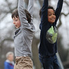 JAY YOUNG | THE GOSHEN NEWS<br /> Parkside Elementary students Alistair Eikler, left, and Isaya Maggtti hang on as they spin around during recess on Wednesday afternoon.
