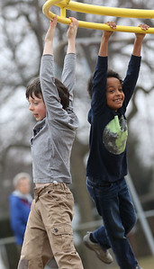 JAY YOUNG | THE GOSHEN NEWS Parkside Elementary students Alistair Eikler, left, and Isaya Maggtti hang on as they spin around during recess on Wednesday afternoon.