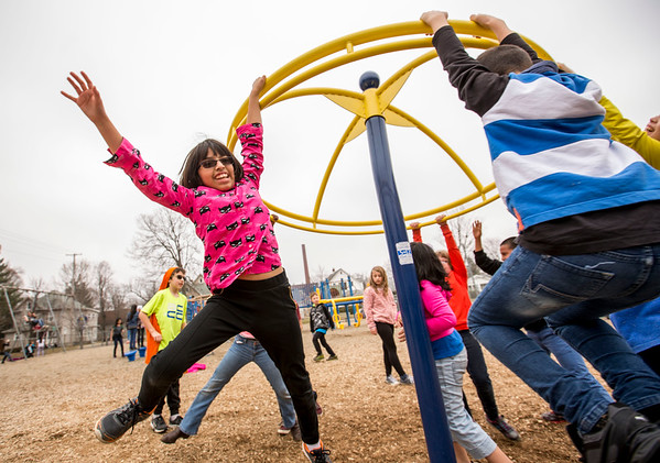 JAY YOUNG | THE GOSHEN NEWS<br /> Parkside Elementary student Rosa Powell hangs on as she spins through the air during recess on Wednesday afternoon.