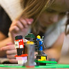 JAY YOUNG | THE GOSHEN NEWS<br /> A blue ninja stands guard while seven-year-old Isabella Burkholder builds a house for the ninja during a Lego Club meeting Tuesday afternoon at Middlebury Public Library.
