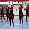 Roger Schneider | The Goshen News<br /> Jumping with their wooden show rifles,  members of the Northridge Winter Guard team perform at the Goshen invitational Saturday. Pictured are, from left, Haylie Koss, Dani Lowell, Morgan Pooters, Abigail Davis and Lora Wilson