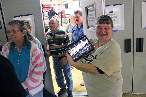 Roger Schneider | Michelle Taubert shows her tablet that she was using at the Goshen Winter Guard Invitational Saturday to follow the Goshen Winter Percussion team competing in Dayton, Ohio.