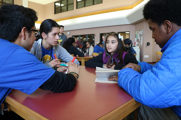 SHERRY VAN ARSDALL | THE GOSHEN NEWS<br /> At right, Jaquay Renfro, a junior at Southwestern Classical Academy in Flint, Michigan, talks with Karina Garcia, a fifth-grader at West Goshen Elementary, and Goshen seniors Ariana Perez Diener and Irving Suarez, during an ice-breaker activity at Goshen High School Thursday.