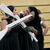Roger Schneider | The Goshen News<br /> Sandra Contreras, left, and Micaela Cacahua perform Saturday during the Gsohen Winter Guard's show.