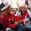"JAY YOUNG | THE GOSHEN NEWS<br /> Wearing Dr. Seuss inspired paper hates and bowties, Chandler Elementary kindergarteners Janie Rodas-Quiroz and Victor Aguilar share a laugh while listening to the Dr. Seuss story, ""The Cat in the Hat,"" on Thursday afternoon.   Thursday was Dr. Seuss' 113th birthday."