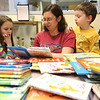 "JAY YOUNG | THE GOSHEN NEWS<br /> Stephanie Fussner, of Goshen, reads the Dr. Seuss book, ""I Wish I Had Duck Feet,"" to her children, Anna, 8, and Peter, 5, at the Goshen Public Library on Thursday morning. Thursday was Dr. Seuss' 113th birthday."