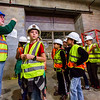 JAY YOUNG | THE GOSHEN NEWS<br /> Syracuse Elementary third-grade student Brock Gest watches construction workers while Wawasee Community Schools superintendent Tom Edington points to a map showing the group where they are during a tour of the new elementary school that is still under construction on Thursday morning.