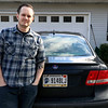 "Geoff Lesar | The Goshen News<br /> Chris Bontrager stands with his car in Goshen Thursday. His license plate request of ""Athe1st"" was denied by the Indiana Bureau of Motor Vehicles."