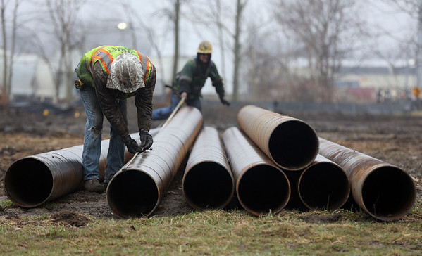 JAY YOUNG | THE GOSHEN NEWS<br /> Work continues on the realignment of U.S. 33. On Tuesday afternoon, workers measure poles that are being used to construct an overpass over Lincoln Ave. Work on the realignment began in May 2016. When completed, U.S. 33 will follow a route that bypasses downtown Goshen.