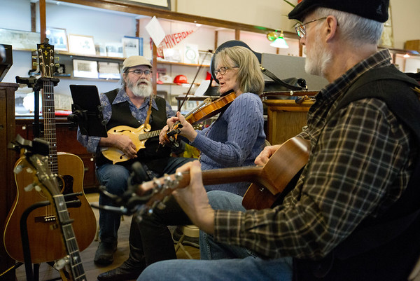 JAY YOUNG   THE GOSHEN NEWS<br /> From left, Steve Seever, Beverly Smith and Steve Braden, of the Waterbound String Band, play a free concert at the Goshen Historical Society Museum during March's Live and Local First Fridays event.