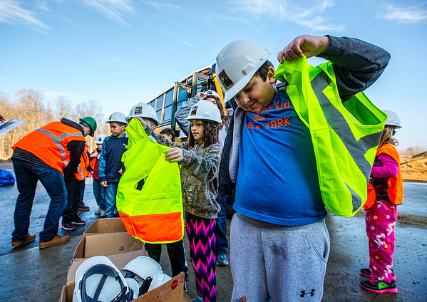 JAY YOUNG | THE GOSHEN NEWS<br /> Syracuse Elementary third-grade student Alexander Reyes puts on a hard hat and yellow safety vest before touring the new elementary school that is still under construction on Thursday morning.