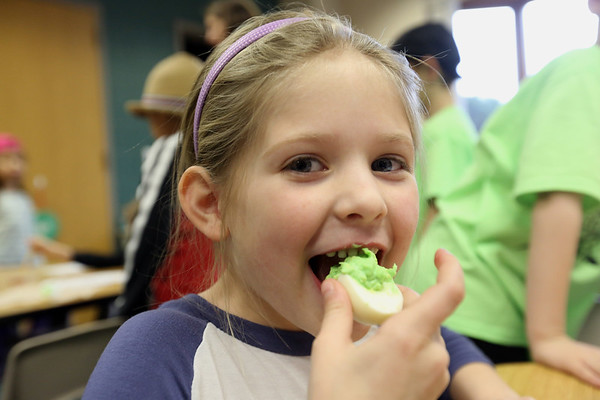 JAY YOUNG | THE GOSHEN NEWS<br /> Jefferson Elementary kindergartener Brayleigh Adams tries some green eggs and ham on Thursday morning.  Thursday was Dr. Seuss' 113th birthday.