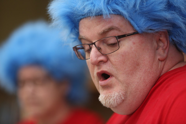 "JAY YOUNG | THE GOSHEN NEWS<br /> Dressed as Thing 2, Kevin Moist reads ""The Cat in the Hat,"" by Dr. Seuss, to Chandler Elementary kindergarten students Thursday afternoon.   Thursday was Dr. Seuss' 113th birthday."