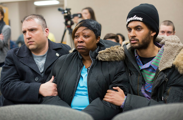 Jay Young | The Goshen News<br /> Tears run down the cheeks of Sandy Holt, sister of Norman Gary, as she is consoled by friends as the grand jury decision not to indict two Elkhart police officers in her brother's death is announced Wednesday at the Goshen City Court.