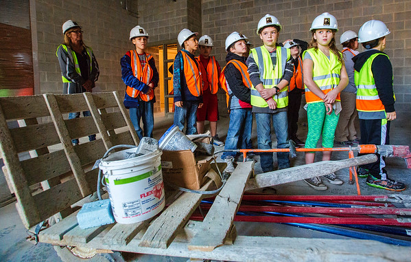 JAY YOUNG | THE GOSHEN NEWS<br /> Syracuse Elementary third-grade students Brock Gest, left, and Breonna Cole look over construction in what will become the music room during a tour of the new elementary school that is still under construction on Thursday morning.