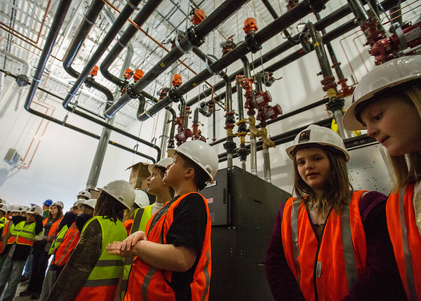 JAY YOUNG | THE GOSHEN NEWS<br /> Syracuse Elementary third-grade students start out in the boiler room during a tour of the new elementary school that is still under construction on Thursday morning.