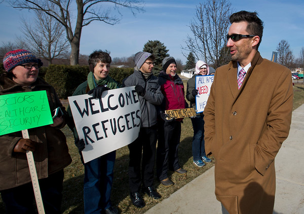 JAY YOUNG | THE GOSHEN NEWS<br /> Goshen Mayor Jeremy Stutsman speaks with protesters as he heads into the Greencroft Community Center for a Chamber of Commerce luncheon where Congresswoman Jackie Walorski was speaking.