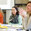 "JAY YOUNG | THE GOSHEN NEWS<br /> Chandler kindergarten teacher Amy Fisher, right, shares a laugh with fellow Chandler kindergarten teachers Erin Behan Morillo, left, and Daisy Gaspar, center, as they talk about teaching strategies during a Tools of the Mind curriculum training program on Thursday morning at the Goshen Community Schools Administration Building. The three Chandler teachers, along with 24 other Goshen and Elkhart kindergarten teachers were recognized for completing the two-year program. ""It's a program that's a curriculum for early childhood,"" Kathy Royer, Associate Director of Horizon Education Alliance, explained. ""It's based on building skills in young children that are both academic and social."" At the end of the session, the teachers will receive a personalized note and a rose congratulating them on completing the program. According to Royer, the teachers have been implementing the curriculum into their classes over the past two years while receiving training."