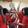 GEOFF LESAR | THE GOSHEN NEWS<br /> <br /> Rebecca Paolillo, right, of Huntington, throws an arm in the air as she and her teammates hoist a trophy following their division win during the Special Olympics' Elkhart County Tip-Off Tournament Saturday afternoon at NorthWood Middle School in Wakarusa.