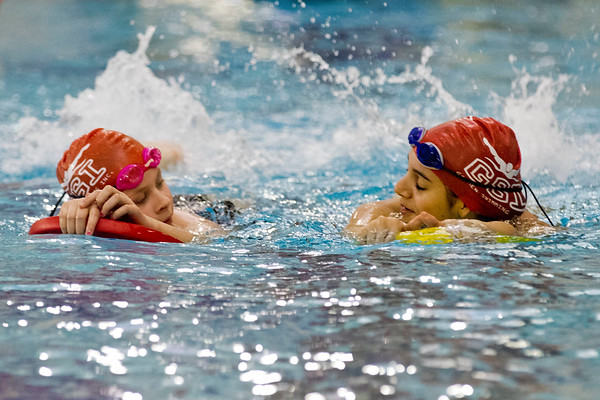 JAY YOUNG | THE GOSHEN NEWS<br /> Fifth-grader Alice Morrison, left, and sixth-grader Casey Farver use floats as they take a leisurely lap at the Goshen Community Schools Aquatics Center on Tuesday after school.