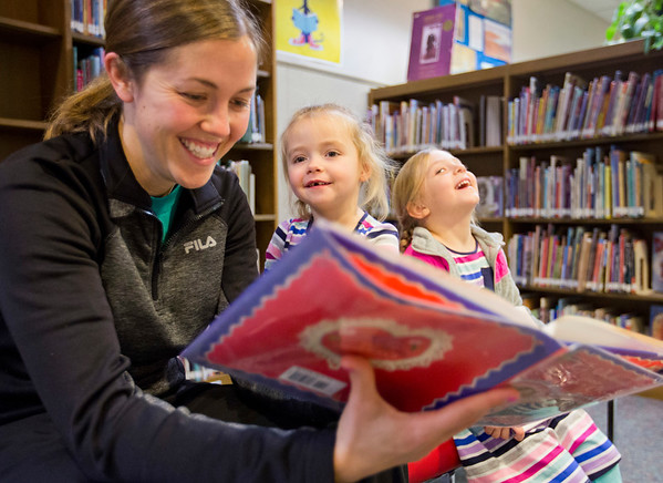 JAY YOUNG| THE GOSHEN NEWS<br /> Three-year-old Elliet Long, center, and her friend Layla Peachey, 4, get a laugh while Long's mother, Theresa, reads A Valentine for Norman Noggs to them on Wednesday morning at the Goshen Public Library.
