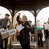 JAY YOUNG | THE GOSHEN NEWS<br /> Karen Jacob of Women's Action for New Directions raises a fist in the air as she addresses protesters inside the gazebo at Celebration Park outside of the Greencroft Community Center on Friday afternoon. About 100 people gathered at the park to protest a variety of issues while Congresswoman Jackie Walorski was speaking at a Chamber of Commerce luncheon inside the community center.