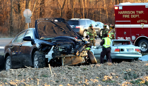 JAY YOUNG | THE GOSHEN NEWS<br /> A car rests in a field while emergency workers work the scene of a two-car head-on collision at the intersection of C.R. 38 and C.R. 9 on Wednesday afternoon.
