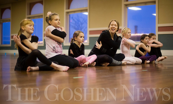 JAY YOUNG | THE GOSHEN NEWS<br /> Youth dance instructor Tricia Blosser ends the first day of her six to eight year old dance class with self hugs on Tuesday afternoon at the Goshen Theater. Tuesday marked the first day of the Goshen Parks and Recreation classes. They will run for the next 16 weeks, cumulating with a dance show on May 6 at the Goshen High School auditorium that will feature over 100 dancers.
