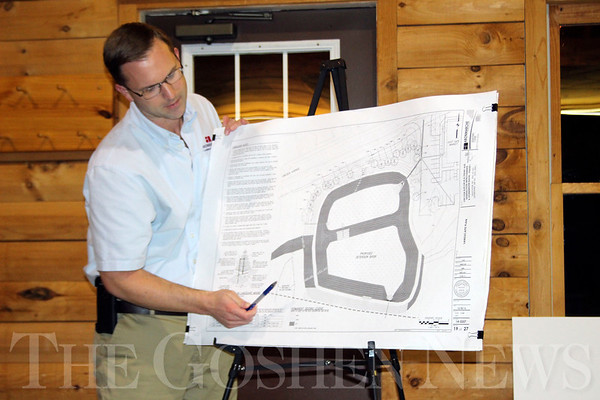 JOHN KLINE | THE GOSHEN NEWS<br /> Brad Mosness of the consulting firm Abonmarche outlines plans for the redevelopment of the former Ramirez Salvage & Towing property on the city's east side during a public meeting at the Abshire Cabin Thursday evening.