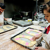 SHEILA SELMAN | THE GOSHEN NEWS<br /> German and Isabel Gutierrez prepare 200 Rosca de Reyes cakes at their bakery Thursday afternoon. Isabel said they expect all cakes will be sold out as usual as Three Kings Day is a popular holiday in Mexico.